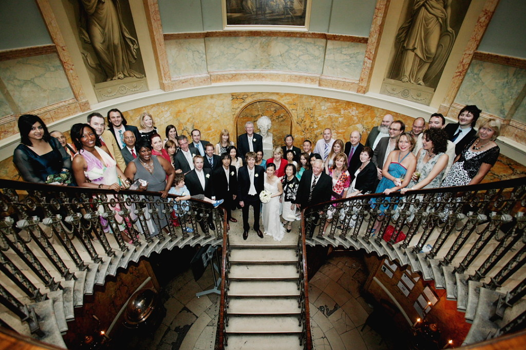 Wedding guests photographed on the spectacular staircase in Home House, Mayfair.